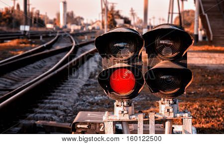 Traffic light shows red signal on railway. Ukrainian railways.