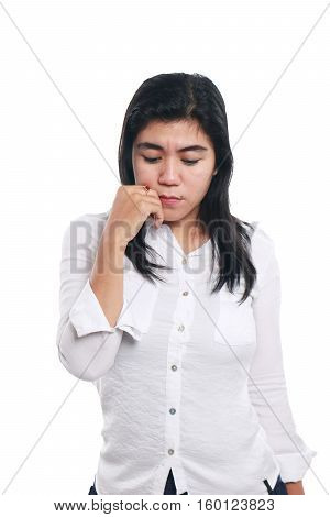Photo image portrait of a sad young Asian businesswoman looking down while thinking of something half body close up portrait over white background
