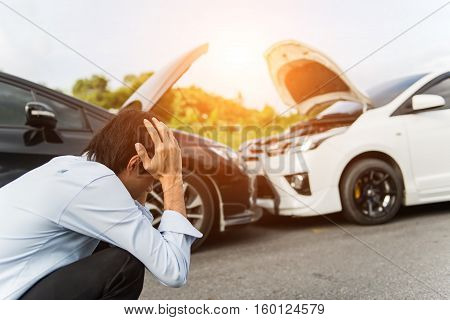 Asia man driver man in front of automobile crash car collision accident in city road select focus