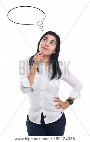 Photo image portrait of a cute young Asian businesswoman smiling while thinking of something half body close up portrait over white with empty dreaming balloon doodle