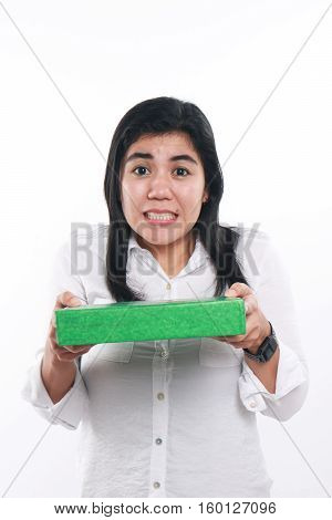 Photo image portrait of a young beautiful Asian woman looking worried and not happy to give green gift package box