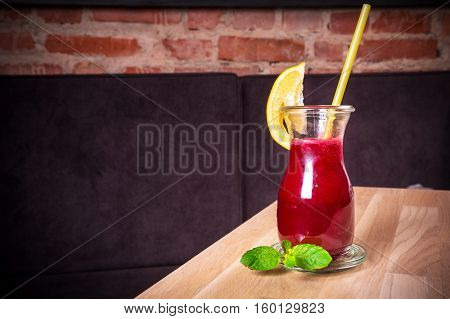 Raw detox beetroot and carrot juice with lemon