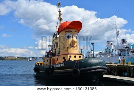 HALIFAX, NS. - AUGUST, 2016:  Theodore the famous little tugboat is docked at Halifax harbour.