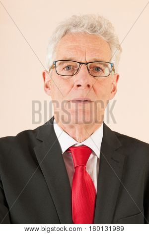 Formally dressed Senior business man with neck tie