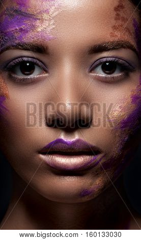 A Beautiful Dark-skinned Woman With Paint On His Face. Beauty, Fashion, Portrait. Creative Make-up C