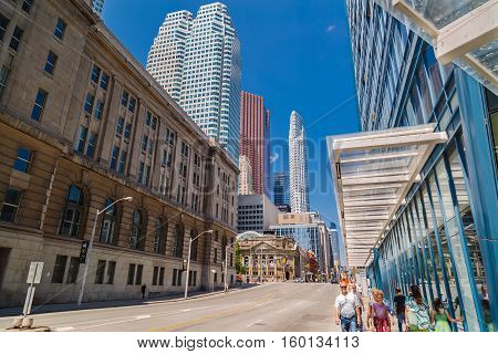 Toronto, Ontario, Canada, May 22, 2016, beautiful inviting Toronto down town landscape view with old vintage and modern buildings with people in foreground enjoying their walking time