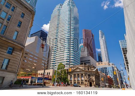 Toronto, Ontario, Canada, May 22, 2016, beautiful inviting Toronto down town landscape view with old vintage and modern buildings, with people in background enjoying their walking time on sunny day