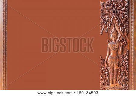Asian wood carved on brown background. Thailand.