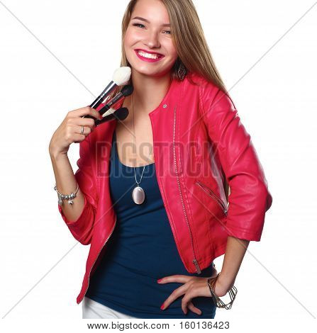 Young beautiful woman holds in hand brush for makeup .