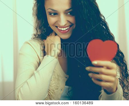 Beautiful smiling caucasian woman with heart symbol.