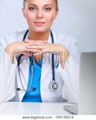 A female doctor working isolated on white background.