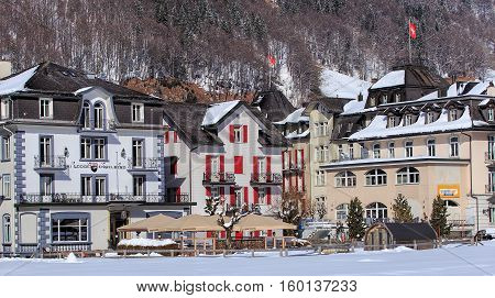Engelberg, Switzerland - 9 March, 2016: buildings along Engelbergerstrasse street. Engelberg is a resort town and municipality in the Swiss canton of Obwalden.