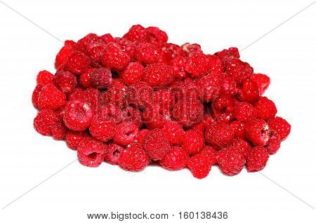 Many berries of bright red raspberry isolated on white background