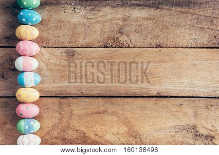 Colorful Pastel Easter Eggs On Wooden Background With Space. Vintage Toned.