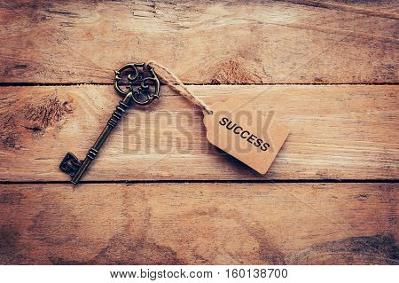 Business Concept - Old Key Vintage On Wood With Tag Success.