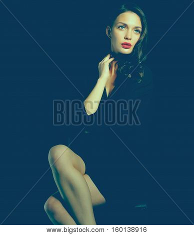 Beautiful woman sitting a chair, isolated on black background .