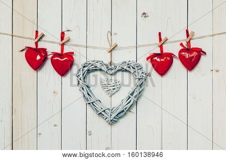 Wooden Rustic Decorative Hearts Hanging On Vintage Wooden Background With Space.