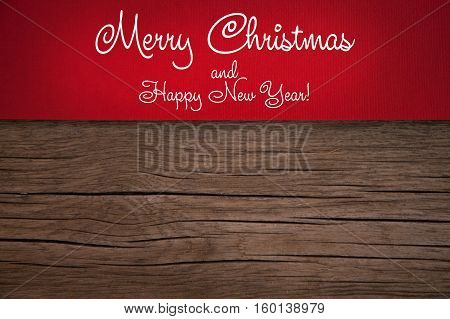 Christmas card, red taxtured paper on wooden old background