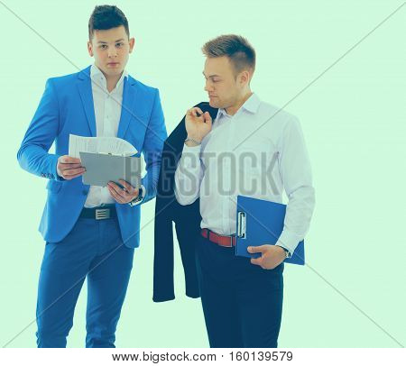 Two business men holding contract folder isolated on white.