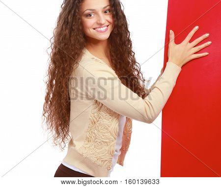Portrait of a casual young woman holding blank card.