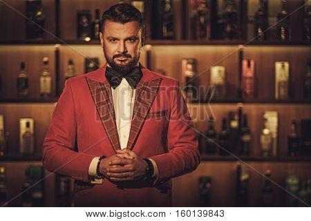 Extravagant stylish man in gentleman club.