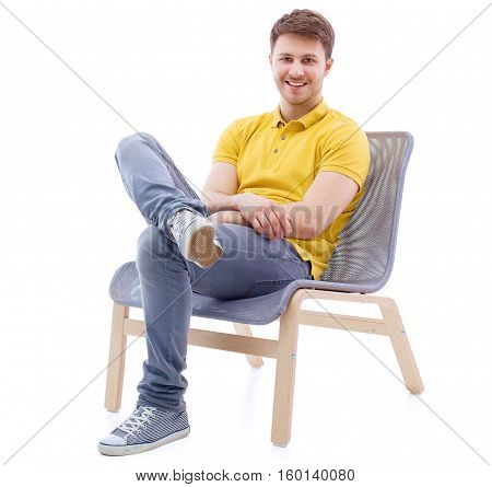 Portrait of smiling happy man sits on the office chair isolated on white