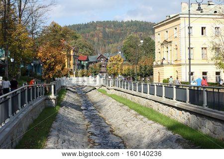 KRYNICA ZDROJ, POLAND - OCTOBER 13, 2016. River in Historic city center of Krynica Zdroj.