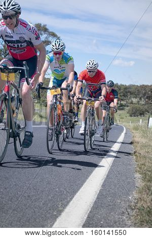 Jindabyne, Snowy Mountains Region, Australia - December 3, 2016: The first L'Etape cycling event held in Australia (by Le Tour de France).  Fatigue is starting to set in at the final hill of the 5th stage of 6.