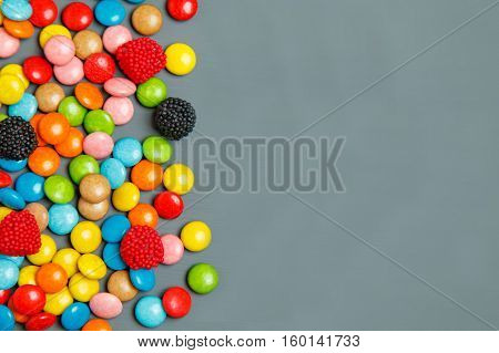 Sweet Color Candies On A Wooden Background