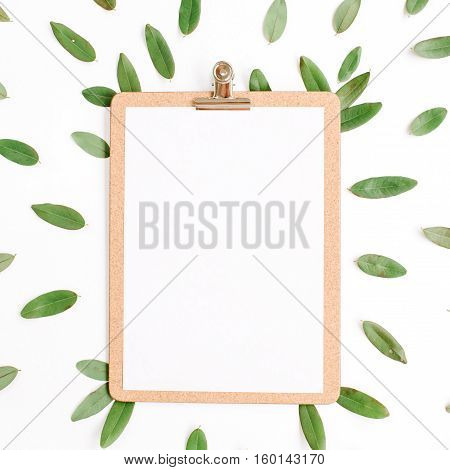 clipboard with green petals isolated on white background. flat lay top view