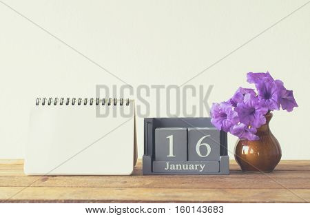 Vintage Wood Calendar For January Day 16 On Wood Table With Empty Note Book Space For Text.