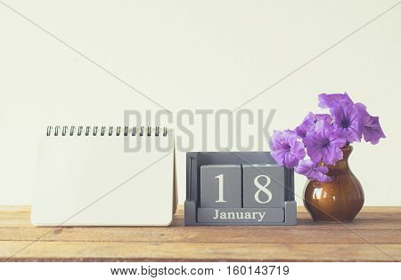 Vintage Wood Calendar For January Day 18 On Wood Table With Empty Note Book Space For Text.