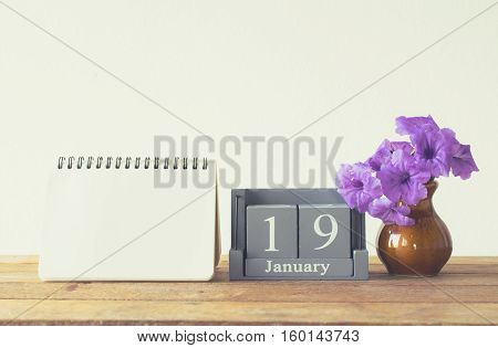 Vintage Wood Calendar For January Day 19 On Wood Table With Empty Note Book Space For Text.