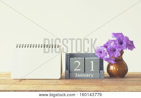 Vintage Wood Calendar For January Day 21 On Wood Table With Empty Note Book Space For Text.