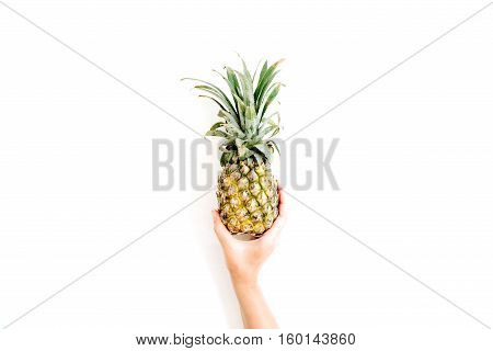 girl's hand holding pineapple. flat lat top view