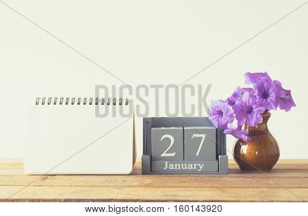 Vintage Wood Calendar For January Day 27 On Wood Table With Empty Note Book Space For Text.