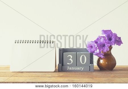 Vintage Wood Calendar For January Day 30 On Wood Table With Empty Note Book Space For Text.
