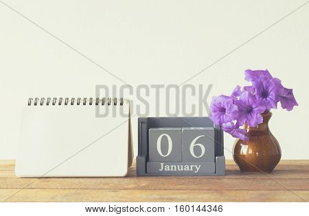 Vintage Wood Calendar For January Day 6 On Wood Table With Empty Note Book Space For Text.