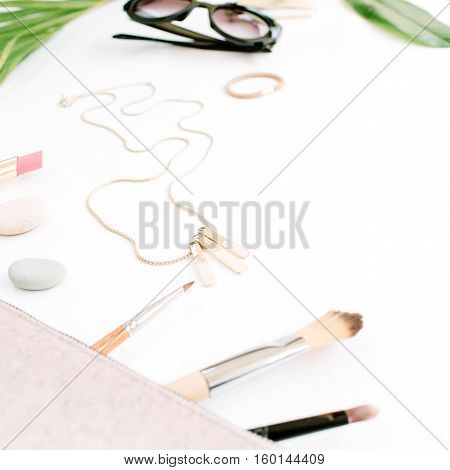feminine purse sunglasses and accessories collage on white. flat lay top view