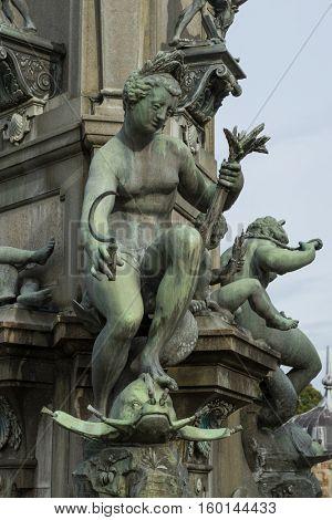 Hillerod, Denmark - September 22, 2016: Detail of the Neptune Fountain, the castle's sculptural masterpiece of Frederiksborg Castle