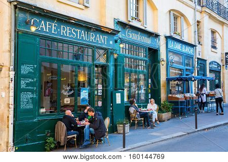 Paris France - October 16 2016: old cafes in the Quartier Latin with unidentified people. Quartier Latin is the traditional student area known for its student life lively atmosphere and bistros