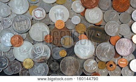Background of Coins from different countries of the world, old, silver, gold, nickel coins and silver dollar