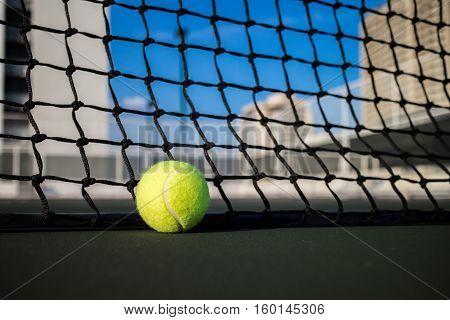 Tennis ball on a tennis hard court