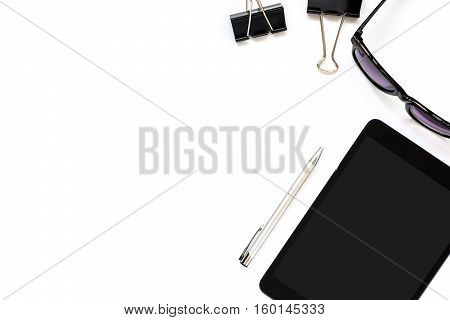 Flat lay photo of office desk with tablet pen sun glasses and paper clip with copy space background