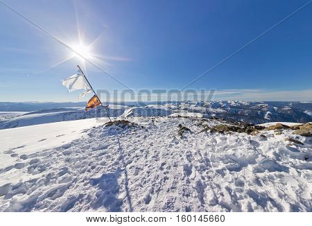 Panorama Tattered Flag On Top Of The Mountain Under Sun