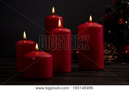 Red candles and christmas tree cones and christmas balls