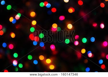 Blurred yellow, green, red, and blue Christmas lights