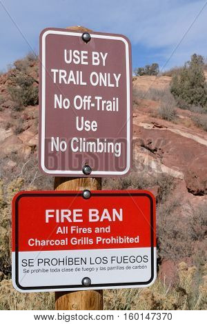 Fire Ban and No Off Trail Use and no Climbing signs at Red Rocks Park, Colorado