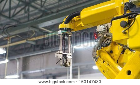 industrial machine and factory robot concept - Yellow robot arm in maintenance unit and copy space. Use for robot factory artwork concept