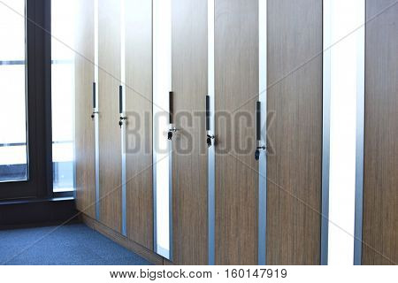 Closed cupboards of modern office